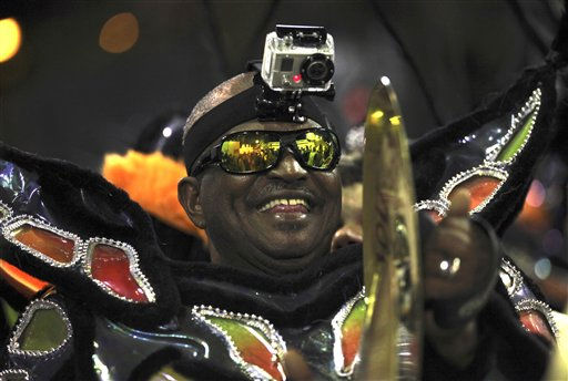 A musician of Uniao da Ilha samba school performs while parading at the Sambadrome in Rio de Janeiro, Brazil, Monday, March 7, 2011. &#40;AP Photo&#47;Silvia Izquierdo&#41; <span class=meta>(AP Photo&#47; Silvia Izquierdo)</span>