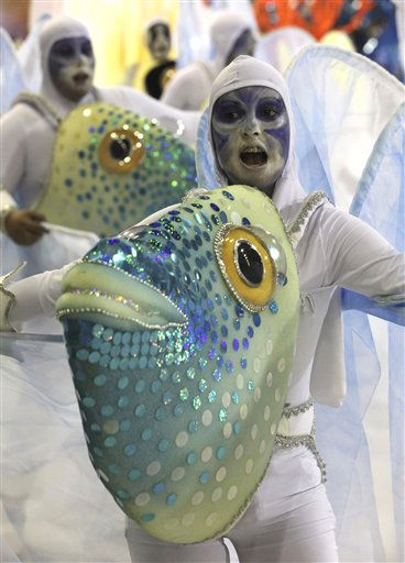 A dancer of Uniao da Ilha samba school parades during carnival celebrations at the Sambadrome in Rio de Janeiro, Brazil, Monday, March 7, 2011.  &#40;AP Photo&#47;Silvia Izquierdo&#41; <span class=meta>(AP Photo&#47; Silvia Izquierdo)</span>