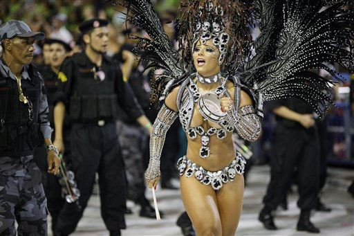 "<div class=""meta ""><span class=""caption-text "">A member of Salgueiro samba school performs while parading during carnival celebrations at the Sambadrome in Rio de Janeiro, Brazil, Tuesday, March 8, 2011. (AP Photo/Felipe Dana) (AP Photo/ Felipe Dana)</span></div>"