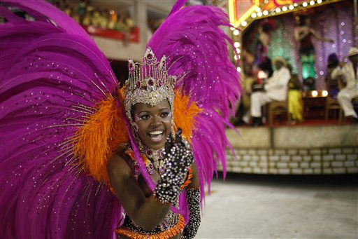 A member of Salgueiro samba school performs while parading during carnival celebrations at the Sambadrome in Rio de Janeiro, Brazil, Tuesday, March 8, 2011. &#40;AP Photo&#47;Felipe Dana&#41; <span class=meta>(AP Photo&#47; Felipe Dana)</span>
