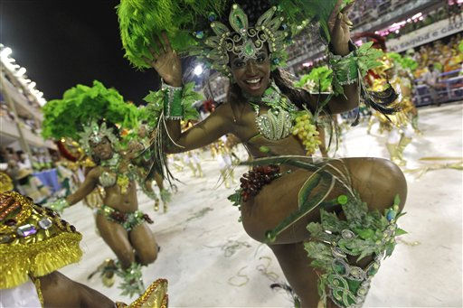 A member of Mocidade Independente samba school performs while parading during carnival celebrations at the Sambadrome in Rio de Janeiro, Brazil, Tuesday, March 8, 2011. &#40;AP Photo&#47;Silvia Izquierdo&#41; <span class=meta>(AP Photo&#47; Silvia Izquierdo)</span>