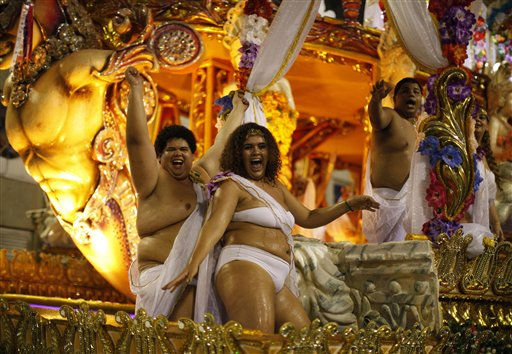 Mocidade Independente samba school dancers perform while parading through the Sambadrome during carnival celebrations in Rio de Janeiro, Brazil, Tuesday March 8, 2011. &#40;AP Photo&#47;Felipe Dana&#41; <span class=meta>(AP Photo&#47; Felipe Dana)</span>