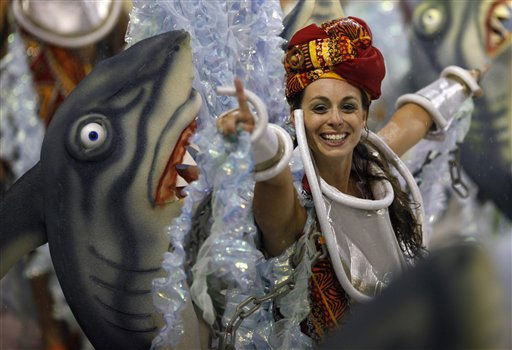 "<div class=""meta ""><span class=""caption-text "">A dancer of Grande Rio samba school smiles while parading through the Sambadrome during carnival celebrations in Rio de Janeiro, Brazil, Tuesday, March 8, 2011. (AP Photo/Felipe Dana) (AP Photo/ Felipe Dana)</span></div>"