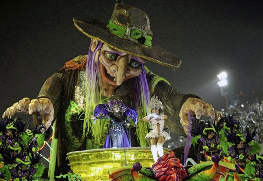 "<div class=""meta ""><span class=""caption-text "">Grande Rio samba school dancers perform while parading through the Sambadrome during carnival celebrations in Rio de Janeiro, Brazil, Tuesday March 8, 2011. (AP Photo/Silvia Izquierdo) (AP Photo/ Silvia Izquierdo)</span></div>"