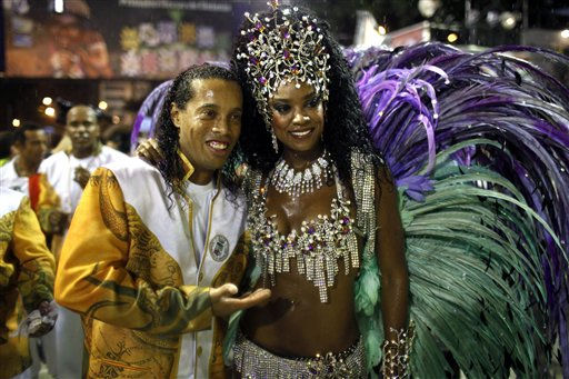 Brazilian soccer player Ronaldinho, left, embraces Cris Vianna, queen of the drums&#39; section of the Grande Rio samba school, while posing for pictures during carnival celebrations at the Sambadrome in Rio de Janeiro, Brazil, Tuesday, March 8, 2011. &#40;AP Photo&#47;Felipe Dana&#41; <span class=meta>(AP Photo&#47; Felipe Dana)</span>