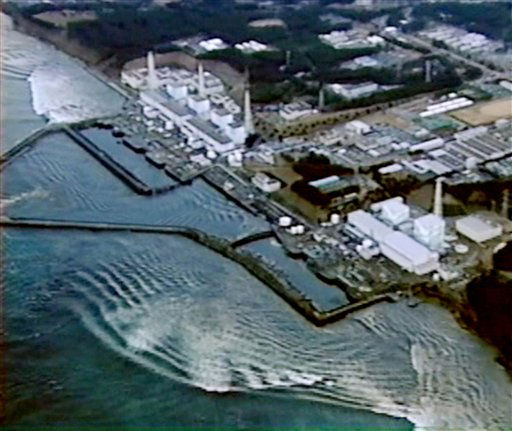 In this photo released by Ministry of Land, Infrastructure, Transport and Tourism via Kyodo News, backrush of tsunami hitting Fukushima Dai-ichi nuclear power plant in Okumamachi, Fukushima Prefecture, Japan, is seen on March 11, 2011.  <span class=meta>(AP Photo&#47; Anonymous)</span>
