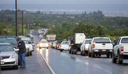 "<div class=""meta image-caption""><div class=""origin-logo origin-image ""><span></span></div><span class=""caption-text"">Due to a tsunami warning hundreds of cars line Kamehameha Highway leading into the town of Haleiwa as residents of the north shore community wait for the all clear to return home Friday, March 11, 2011 in Honolulu. An 8.9-magnitude earthquake struck Japan and sent a tsunami wave across the Pacific. (AP Photo/Eugene Tanner) (AP Photo/ Eugene Tanner)</span></div>"
