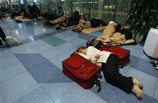 "<div class=""meta ""><span class=""caption-text "">Travelers rest on the floor stranded at the Haneda international airport in Tokyo after a massive earthquake Friday, March 11, 2011. The ferocious tsunami spawned by one of the largest earthquakes ever recorded slammed Japan's eastern coasts. (AP Photo/Wally Santana) (AP Photo/ Wally Santana)</span></div>"