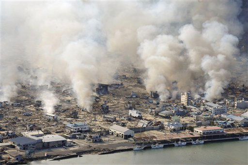 "<div class=""meta ""><span class=""caption-text "">White smokes rise from still burning house in Yamadamachi in Iwate Prefecture (state), northern Japan, Saturday, March 12, 2011, one day after a strong earthquake-triggered devastating tsunami hit the area. (AP Photo/Kenji Shimizu, The Yomiuri Shimbun)  JAPAN OUT, CREDIT MANDATORY (AP Photo/ Kenji Shimizu)</span></div>"