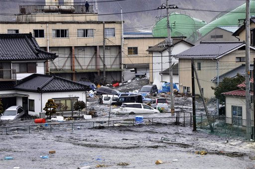 RETRANSMISSION WITH BETTER QUALITY - An earthquake-triggered tsunami washes away a warehouse and vehicles in Kesennuma, Miyagi prefecture &#40;state&#41;, Japan,  Friday, March 11, 2011. The ferocious tsunami spawned by one of the largest earthquakes ever recorded slammed Japan&#39;s eastern coasts. &#40;AP Photo&#47;The Yomiuri Shimbun&#41; JAPAN OUT, CREDIT MANDATORY <span class=meta>(AP Photo&#47; Anonymous)</span>