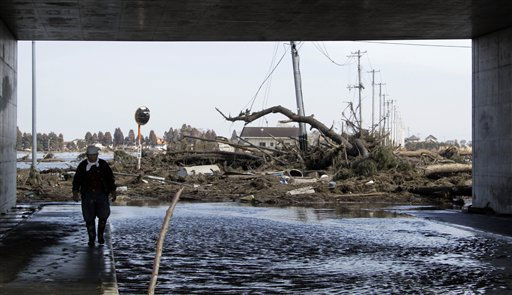 Ryohei Aihara, 74, walks by debris in Sendai, northeastern Japan, Saturday, March 12, 2011, following Friday&#39;s 8.9-magnitude quake and the tsunami it spawned hit the country&#39;s northeastern coast. &#40;AP Photo&#47;Koji Sasahara&#41; <span class=meta>(AP Photo&#47; Koji Sasahara)</span>