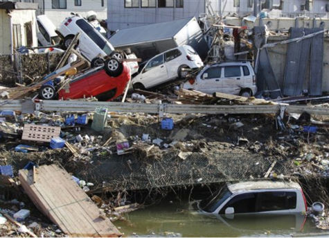 "<div class=""meta ""><span class=""caption-text "">Displaced vehicles are seen at Sendai Port in Sendai, northeastern Japan, Saturday, March 12, 2011, following Friday's 8.9-magnitude quake and the tsunami it spawned hit the country's northeastern coast. (AP Photo/Koji Sasahara) (AP Photo/ Koji Sasahara)</span></div>"