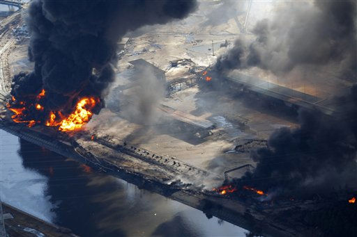 "<div class=""meta ""><span class=""caption-text "">Smoke ascends over an industrial area as flames are seen in Sendai, northern Japan, Saturday, March 12, 2011. Japan launched a massive military rescue operation Saturday after a giant, quake-fed tsunami killed hundreds of people and turned the northeastern coast into a swampy wasteland, while authorities braced for a possible meltdown at a nuclear reactor. (AP Photo/Itsuo Inouye) (AP Photo/ Itsuo Inouye)</span></div>"
