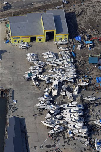 Vessels get displaced in Sendai, northern Japan, Saturday, March 12, 2011. Japan launched a massive military rescue operation Saturday after a giant, quake-fed tsunami killed hundreds of people and turned the northeastern coast into a swampy wasteland, while authorities braced for a possible meltdown at a nuclear reactor. &#40;AP Photo&#47;Itsuo Inouye&#41; <span class=meta>(AP Photo&#47; Itsuo Inouye)</span>