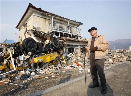 "<div class=""meta ""><span class=""caption-text "">A man stands near a damaged house in Ofunato, Iwate Prefecture, northern Japan, Sunday, March 13, 2011, two days after a powerful earthquake-triggered tsunami hit Japan's east coast. (AP Photo/Shizuo Kambayashi) (AP Photo/ Shizuo Kambayashi)</span></div>"