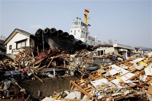 A vessel sits on the rubble in Ofunato, Iwate Prefecture, northern Japan, Sunday, March 13, 2011, two days after a powerful earthquake-triggered tsunami hit Japan&#39;s east coast. &#40;AP Photo&#47;Shizuo Kambayashi&#41; <span class=meta>(AP Photo&#47; Shizuo Kambayashi)</span>