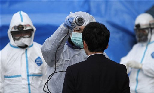 An official scans a man for radiation at an emergency center Sunday, March 13, 2011, in Koriyama, northeastern Japan, two days after a giant quake and tsunami struck the country&#39;s northeastern coast.&#40;AP Photo&#47;Gregory Bull&#41; <span class=meta>(AP Photo&#47; Gregory Bull)</span>