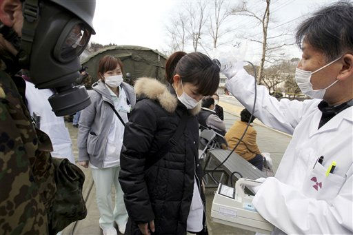 A hospital worker who was flown from a shelter by helicopter receives a check for radiation contamination, in Nihonmatsu, Fukushima, northern Japan Sunday, March 13, 2011 after Friday&#39;s catastrophic earthquake and tsunami. &#40;AP Photo&#47;Asahi Shimbun, Toru Nakata&#41;  JAPAN OUT, NO SALES, MANDATORY CREDIT <span class=meta>(AP Photo&#47; Toru Nakata)</span>