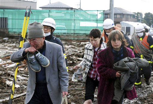 Residents make their way through a devastated area in Sendai, northern Japan Saturday, March 12, 2011 after Friday&#39;s catastrophic earthquake and tsunami. &#40;AP Photo&#47;Asahi Shimbun&#41; JAPAN OUT, NO SALES, MANDATORY CREDIT <span class=meta>(AP Photo&#47; Anonymous)</span>