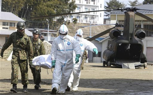 Self-defense force&#39;s members and others carry a resident who is suspected to be exposed to radiation, in Nihonmatsu, Fukushima, northern Japan Sunday, March 13, 2011 following radiation emanation from a nuclear reactor after Friday&#39;s catastrophic earthquake and tsunami. &#40;AP Photo&#47;Yomiuri Shimbun, Daisuke Tomita&#41; JAPAN OUT, CREDIT MANDATORY <span class=meta>(AP Photo&#47; Daisuke Tomita)</span>