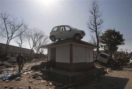 A car sits on top of a small building in a destroyed neighborhood in Sendai, Japan, on Sunday, March 13, 2011 after it was washed into the area by the tsunami that hit northeastern Japan. AP Photo&#47;David Guttenfelder&#41; <span class=meta>(AP Photo&#47; David Guttenfelder)</span>