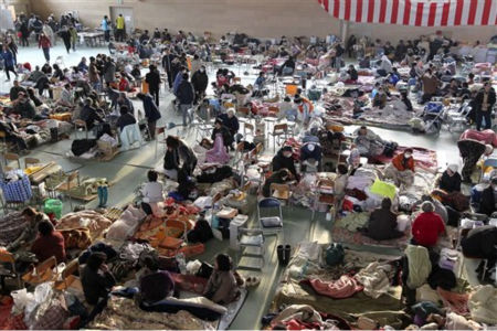 Survivors of Friday&#39;s earthquake and tsunami spend time at an evacuation center in Rikuzentakata in Iwate Prefecture, northeastern Japan, Monday, March 14, 2011. &#40;AP Photo&#47; Park Ji-ho, Yonhap&#41;  KOREA OUT <span class=meta>(AP Photo&#47; Park Ji-ho)</span>