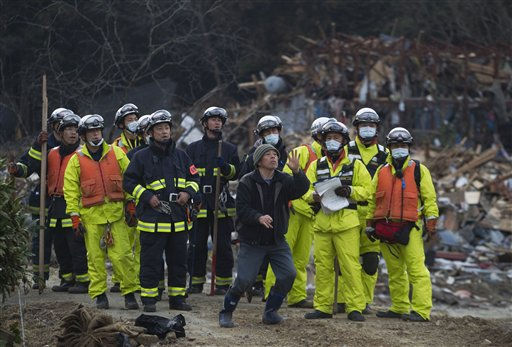 "<div class=""meta ""><span class=""caption-text "">A survivor of the tsunami that swept through his village of Saito, in northeastern Japan, retells the story to a rescue team that arrived to search the area Monday, March 14, 2011. Rescue workers used chain saws and hand picks Monday to dig out bodies in Japan's devastated coastal towns, as Asia's richest nation faced a mounting humanitarian, nuclear and economic crisis in the aftermath of a massive earthquake and tsunami that likely killed thousands. (AP Photo/David Guttenfelder) (AP Photo/ David Guttenfelder)</span></div>"