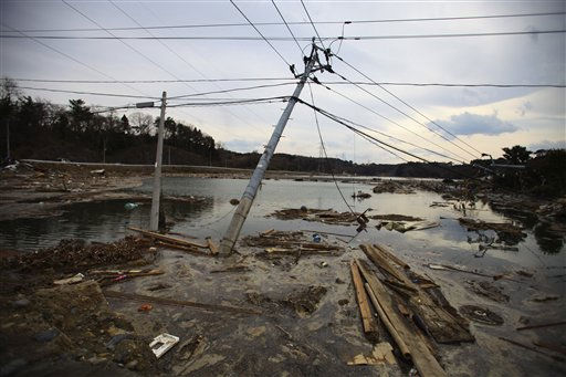 "<div class=""meta image-caption""><div class=""origin-logo origin-image ""><span></span></div><span class=""caption-text"">Leaning electric poles are left in the area following massive tsunami triggered by March 11 earthquake in Daigasaki, near Sendai, Miyagi Prefecture, Japan, Monday, March 14, 2011. (AP Photo/Junji Kurokawa) (AP Photo/ Junji Kurokawa)</span></div>"