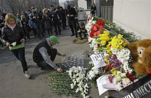 People lay flowers and light candles in front of the Japanese Embassy in Moscow, Russia, Monday, March 14, 2011, in memory of the earthquake&#39;s victims. Japan was hit by a massive 8.9-magnitude earthquake and a following tsunami. The disaster has killed hundreds of people and devastated the country&#39;s northeastern coast. &#40;AP Photo&#47;Misha Japaridze&#41; <span class=meta>(AP Photo&#47; Misha Japaridze)</span>