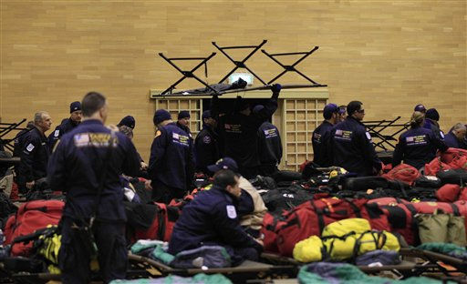 A search and rescue team from Los Angeles County in the U.S. sets up a base to bed in for the night in a gymnasium after arriving at the Setamai school in Sumita, northern Japan, Monday, March 14, 2011. Two search and rescue teams from Fairfax County, Virginia, and Los Angeles County in the U.S. and a team from the U.K. with combined numbers of around 225 personnel have arrived in northern Japan to help in the aftermath of the earthquake and tsunami. &#40;AP Photo&#47;Matt Dunham&#41; <span class=meta>(AP Photo&#47; Matt Dunham)</span>