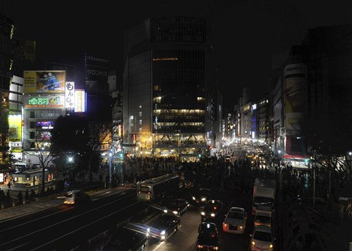 "<div class=""meta ""><span class=""caption-text "">Advertising boards on the buildings are seen without the illumination at Tokyo's Shibuya district Monday, March 14, 2011. The planned blackouts were meant to help make up for a severe shortfall after key nuclear plants were left inoperable due to Friday's earthquake and tsunami. (AP Photo/The Yomiuri Shimbun, Miho Takahashi) JAPAN OUT, MANDATORY CREDIT (AP Photo/ Miho Takahashi)</span></div>"