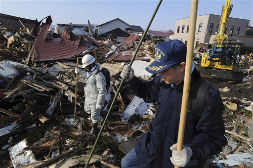 "<div class=""meta ""><span class=""caption-text "">Local firefighting volunteers seek survivors at the devastated Noda village, northern Japan, Monday, March 14, 2011, three days after a powerful earthquake-triggered tsunami hit the country's east coast. (AP Photo/The Yomiuri Shimbun, Yoichi Hayashi) JAPAN OUT, MANDATORY CREDIT (AP Photo/ Yoichi Hayashi)</span></div>"