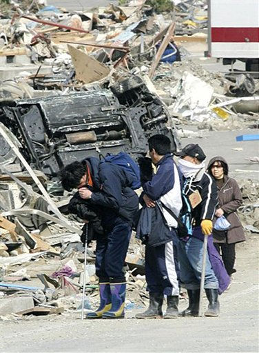 A man cries while walking through the devastated town of Onagawa, Miyagi Prefecture, Monday, March 14, 2011, three days after a powerful earthquake-triggered tsunami hit the country&#39;s east coast. &#40;AP Photo&#47;The Yomiuri Shimbun, Makoto Kondo&#41; JAPAN OUT, MANDATORY CREDIT <span class=meta>(AP Photo&#47; Makoto Kondo)</span>