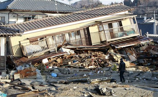 "<div class=""meta image-caption""><div class=""origin-logo origin-image ""><span></span></div><span class=""caption-text"">A residents of the seaside town of Yotsukura, northern Japan, walks past damaged homes Monday, March 14, 2011, three days after a giant quake and tsunami struck the country's northeastern coast. (AP Photo/Mark Baker) (AP Photo/ Mark Baker)</span></div>"