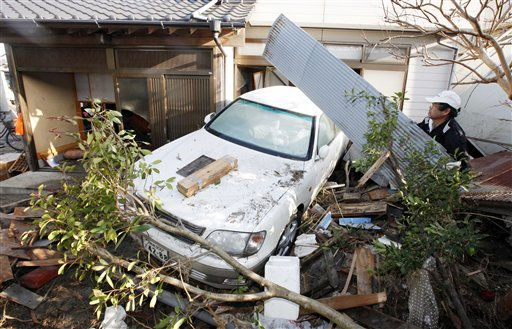 "<div class=""meta ""><span class=""caption-text "">A resident of the seaside town of Yotsukura, northern Japan, clears debris from his home Monday, March 14, 2011, three days after a giant quake and tsunami struck the country's northeastern coast. (AP Photo/Mark Baker) (AP Photo/ Mark Baker)</span></div>"