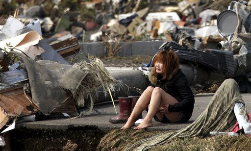 "<div class=""meta ""><span class=""caption-text "">ALTERNATE CROP - A woman reacts amidst debris caused by Friday's massive earthquake and the ensuing tsunami, in Natori, northern Japan Sunday, March 13, 2011. (AP Photo/Asahi Shimbun, Toshiyuki Tsunenari) JAPAN OUT, NO SALES, MANDATORY CREDIT (AP Photo/ Toshiyuki Tsunenari)</span></div>"