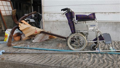 A wheelchair stands outside a home in the seaside town of Yotsukura, Japan, showing the water mark Monday, March 14, 2011, three days after a giant quake and tsunami struck the country&#39;s northeastern coast. &#40;AP Photo&#47;Mark Baker&#41; <span class=meta>(AP Photo&#47; Mark Baker)</span>