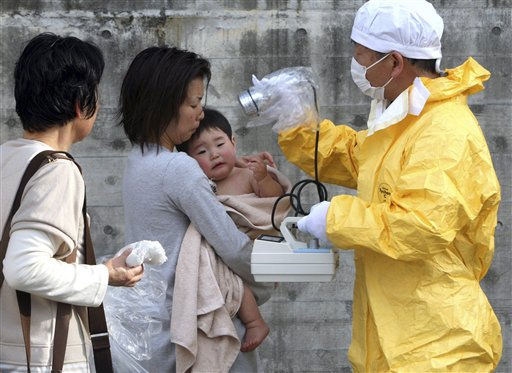 A one-year-old boy is re-checked for radiation exposure after being decontaminated in Nihonmatsu, Fukushiima, northern Japan Monday, March 14, 2011. &#40;AP Photo&#47;Asahi Shimbun, Toru Nakata&#41; JAPAN OUT, MANDATORY CREIDT, NO SALES <span class=meta>(AP Photo&#47; Toru Nakata)</span>