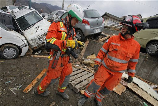 "<div class=""meta ""><span class=""caption-text "">Members of the British rescue team work in the tsunami-hit area in Ofunato, Iwate Prefecture, Japan, Tuesday, March 15, 2011, four days after the disaster. (AP Photo/Itsuo Inouye) (Photo/Itsuo Inouye)</span></div>"