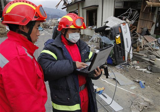 "<div class=""meta ""><span class=""caption-text "">Members of the Chinese rescue team work in the tsunami-hit area in Ofunato, Iwate Prefecture, Japan, Tuesday, March 15, 2011, four days after the disaster. (AP Photo/Itsuo Inouye) (Photo/Itsuo Inouye)</span></div>"