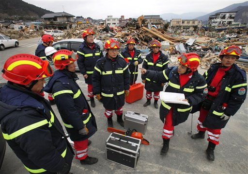 "<div class=""meta ""><span class=""caption-text "">Members of the Chinese rescue team are briefed by their leader during their operations in the tsunami-hit area in Ofunato, Iwate Prefecture, Japan, Tuesday, March 15, 2011, four days after the disaster. (AP Photo/Itsuo Inouye) (Photo/Itsuo Inouye)</span></div>"