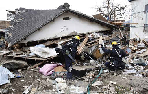 Los Angeles County Fire Dept. rescue team members search for survivors in a damaged house in Ofunato, Iwate Prefecture, northern Japan, Tuesday, March 15, 2011, four days after a powerful earthquake-triggered tsunami hit Japan&#39;s east coast. &#40;AP Photo&#47;Shizuo Kambayashi&#41; <span class=meta>(Photo&#47;Shizuo Kambayashi)</span>