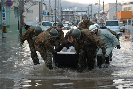In this Saturday March 12, 2011, photo released by the Japan Defense Ministry, Japanese troopers escort a local resident as they help the evacuation of stranded people at Tagajo, northeastern Japan, after Friday&#39;s earthquake and the ensuing tsunami. &#40;AP Photo&#47;Japan Defense Ministry&#41; EDITORIAL USE ONLY <span class=meta>(AP Photo&#47; Anonymous)</span>