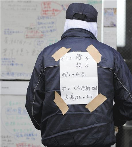 "<div class=""meta ""><span class=""caption-text "">An evacuee, with a note of  family names, looks for the family members through a shelter in Ishinomaki, northern Japan Tuesday, March 15, 2011 following Friday's massive earthquake and the ensuing tsunami. (AP Photo/Yomiuri Shimbun, Koji Ito) JAPAN OUT, MANDATORY CREDIT (AP Photo/ Koji Ito)</span></div>"
