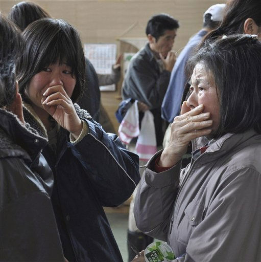 In this March 14, 2011 photo, tsunami survivors cry after reuniting each other at an evacuation center in Rikuzentakata in Iwate Prefecture &#40;state&#41;, northern Japan following Friday&#39;s massive earthquake and tsunami. &#40;AP Photo&#47;Yomiuri Shimbun, Sho Komine&#41; JAPAN OUT, MANDATORY CREDIT <span class=meta>(AP Photo&#47; Sho Komine)</span>
