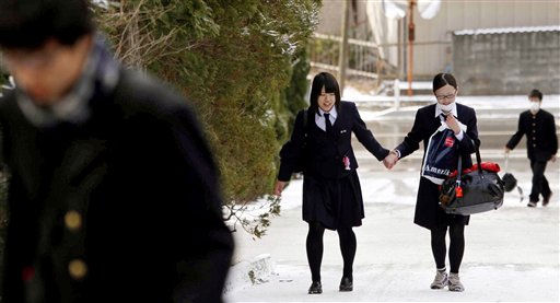 "<div class=""meta image-caption""><div class=""origin-logo origin-image ""><span></span></div><span class=""caption-text"">High school students go to school in Ofunato, northern Japan, Thursday, March 17, 2011. It was their first time going back to school since Friday's powerful earthquake-triggered tsunami hit Japan's northeast coast. (AP Photo/Kyodo News) (Photo/Anonymous)</span></div>"