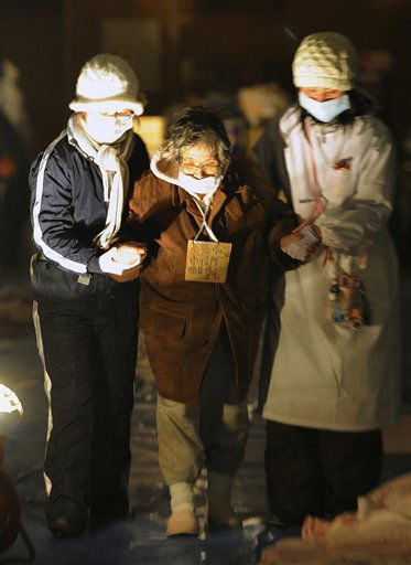 Nurses help a woman transfer from Ishimaki Red Cross Hospital to a makeshift shelter in Ishimaki, northern Japan, Thursday, March 17, 2011, after Friday&#39;s powerful earthquake-triggered tsunami hit Japan&#39;s northeast coast. &#40;AP Photo&#47;Kyodo News&#41; <span class=meta>(Photo&#47;Anonymous)</span>