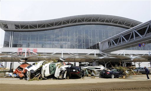 Tsunami-swept vehicles lie at Sendai airport in Sendai, northeastern Japan, on Thursday, March 17, 2011 following last week&#39;s massive earthquake and resulting tsunami. &#40;AP Photo&#47;Kyodo News&#41; JAPAN OUT, MANDATORY CREDIT, NO LICENSING IN CHINA, HONG KONG, JAPAN, SOUTH KOREA AND FRANCE <span class=meta>(AP Photo&#47; Anonymous)</span>