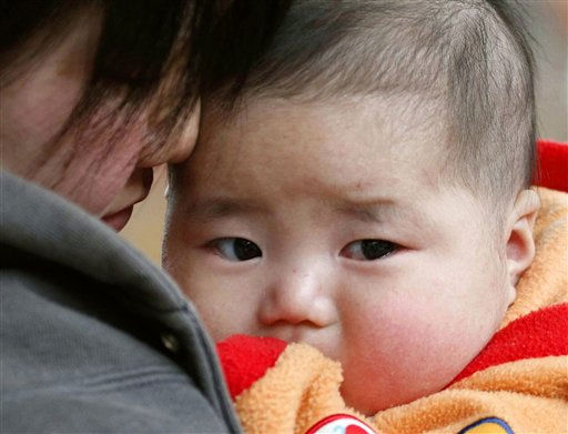 "<div class=""meta image-caption""><div class=""origin-logo origin-image ""><span></span></div><span class=""caption-text"">An evacuee holds her baby at a shelter in Ofunato, Iwate Prefecture, northeastern Japan, Thursday, March 17, 2011, after Friday's earthquake and tsunami. (AP Photo/Kyodo News)   (AP Photo/ Anonymous)</span></div>"