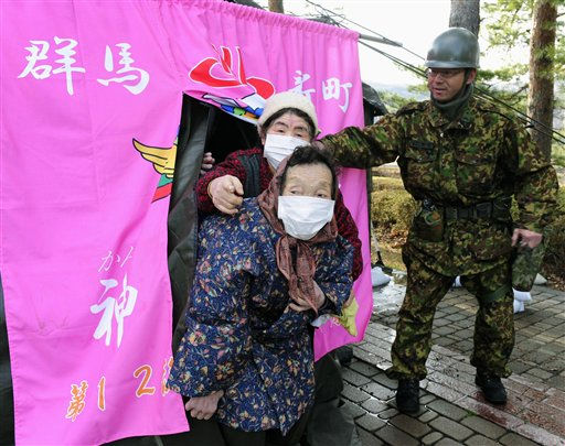 Evacuees come out of a temporary bath set up by the Japan Ground Self-Defense Force in the compound of a shelter in Fukushima, northern Japan, Thursday, March 17, 2011. &#40;AP Photo&#47;Kyodo News&#41; <span class=meta>(Photo&#47;Anonymous)</span>